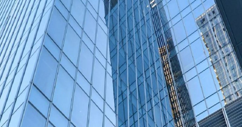 Ultra low radiation coated glass building